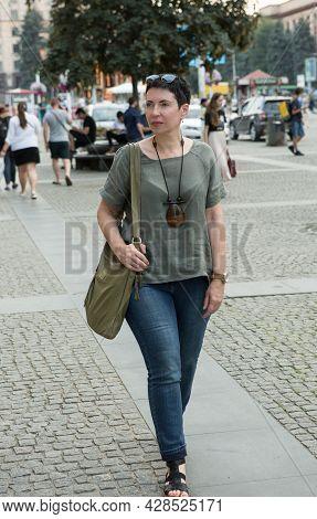 Dnepropetrovsk, Ukraine - 07.28.2021: A Beautiful Stylish Middle-aged Woman Walks Around The City. B