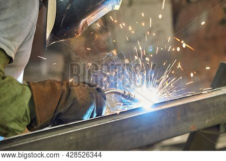 Man Processes Metal With Gas Electric Welding.