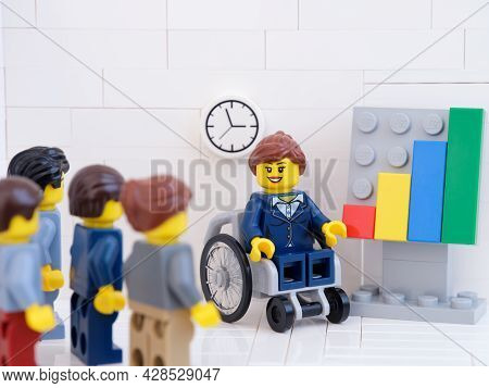 Tambov, Russian Federation - July 22, 2021 Lego Businesspeople Minifigures Having A Meeting And Disc