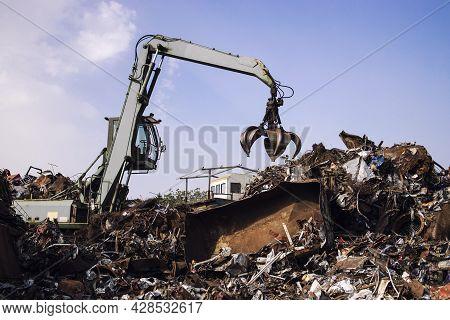 Industrial Scrap Metal Or Iron Recycling In Junkyard.