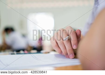 Teenage Hands Students Learning Exams In Classroom. School Student's Read Note Taking Assessment Wri