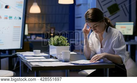 Entrepreneur Woman Hardworking In Office Meeting Room Analyzing Company Documents Looking At Managem