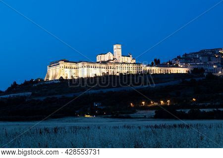 Assisi Basilica By Night In Umbria Region, Italy. The Town Is Famous For The Most Important Italian