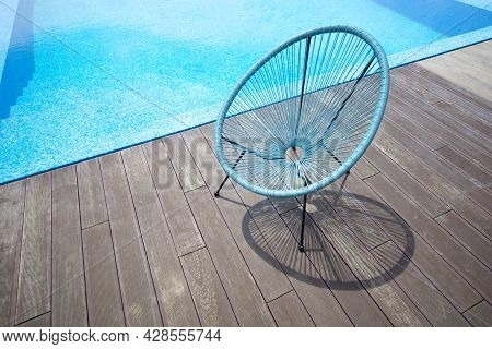 Summer Wicker Chair On The Wooden Terrace By The Poolside