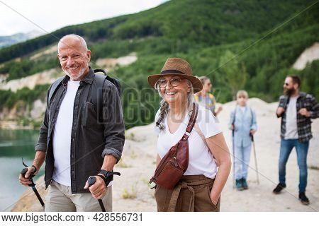 Happy Multigeneration Family On Hiking Trip On Summer Holiday, Walking.
