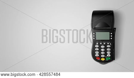 Payment terminal POS on the gray background with copy space, including clipping path