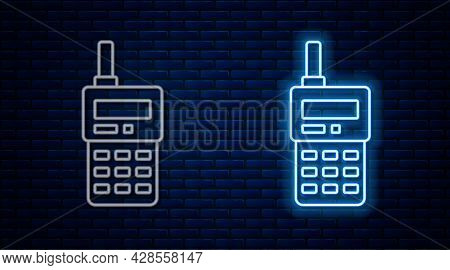 Glowing Neon Line Walkie Talkie Icon Isolated On Brick Wall Background. Portable Radio Transmitter I