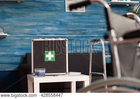 Hospital Medical Bag Equipment Standing On Table In Empty Living Room With Nobody In It During Healt