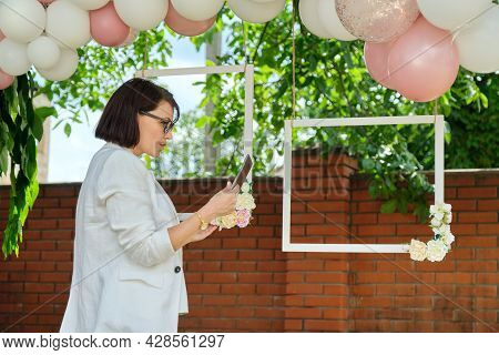 Decorating The Garden With Balloons For A Party, Ceremony