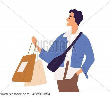 Young Stylish Man Holding Shop Bags With Purchases In Hands. Male Shopper Walking After Shopping. Mo