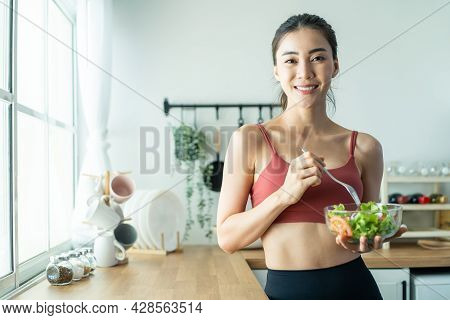 Portrait Of Asian Attractive Woman Hold Salad Bowl And Look At Camera. Beautiful Sport Girl In Sport