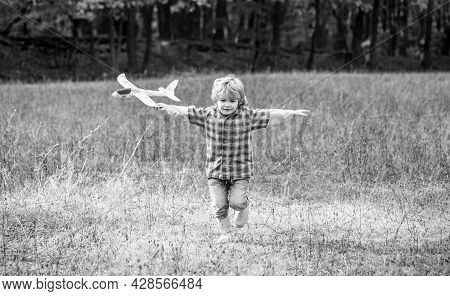 Little Boy With Plane. Little Kid Dreams Of Being A Pilot. Child Playing With Toy Airplane. Happy Ch