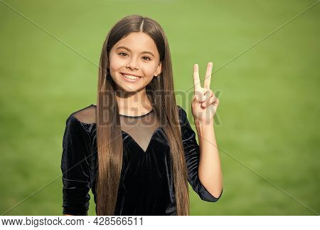 Give Child Peaceful Childhood. Happy Kid Show Peace Sign Green Grass. Happy Childrens Day. Maternity