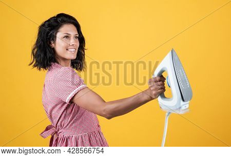 Iron Works Everywhere. Retro Girl With Electric Iron. Vintage Woman Ironing Clothes. Housekeeping. P