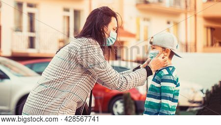 Mother, Child Wear Facemask During Coronavirus, Flu Outbreak. Mom With A Son In A Medical Mask. Mom
