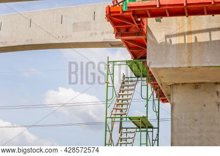 Stairs And Scaffolding Structures At Construction Of A Mass Transit Train Line In Progress With Heav