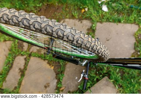 Bike Waiting Mechanic For Repair In Bicycle Repair Shop, Outdoor. Bicycle Wheel Close Up Ready For E