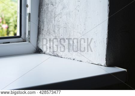 Mould And Rot On Corner Of Plastic Window Frame And Cement Wall