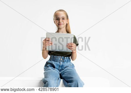 One Smart Teen School Caucasian Girl In Casual Clothes And Glasses Holding Tablet Isolated Over Whit