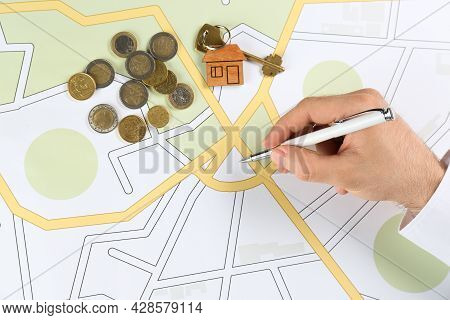 Cartographer With House Key And Money Drawing Cadastral Map, Closeup