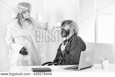 Coronavirus Symptoms. Doctor Protective Equipment Examines Male Patient Suspected Coronavirus Infect