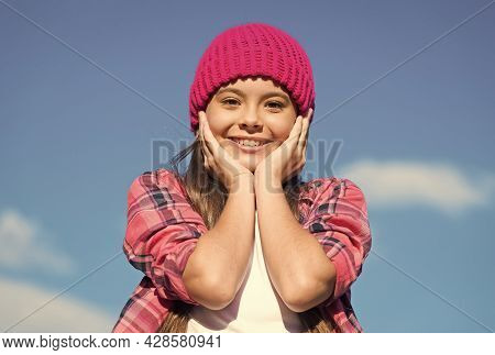 Sunny Skincare. Happy Girl Touch Face Skin On Blue Sky. Beauty Look Of Little Child. Summer Skincare