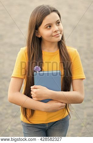 Thoughtful Kid Holding Book. Small Girl Thinking Outdoor. School Education In Modern Life. Back To S