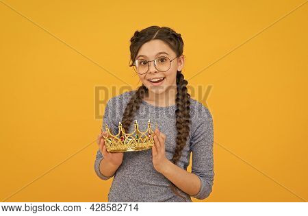 Cute Adorable Girl In Glasses. Princess Concept. Happy Smiling Princess. Excellent Pupil. Success An