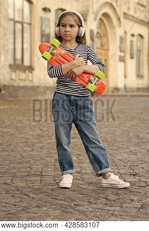 Active Vacation. Small Child Hold Penny Board Outdoors. Skateboarding As Transportation. Skate Trip.