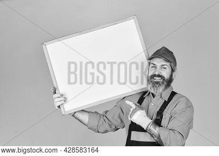 Repair Price List. Mechanic Perform Repair. Man Hold Chalkboard Copy Space. Electrician Plumber Hand
