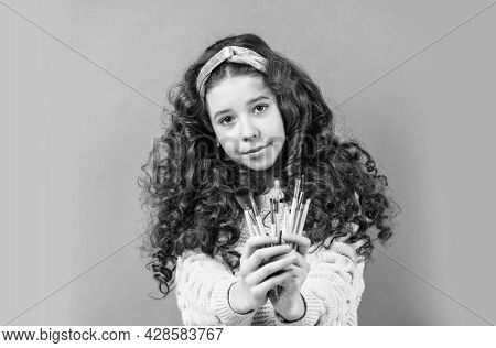 Apply Cosmetics. Skin Care Cosmetics For Young Skin. Happy Girl With Hairband Hold Brushes For Makeu