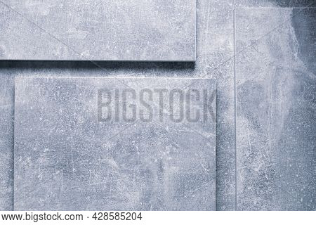 Abstract grey background texture at table or wall surface. Gray piece of chipboard background surface