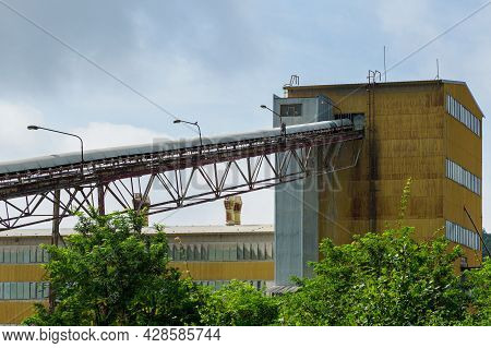 Big Silos, Belt Conveyors And Mining Equipment In A Quarry. Mining Industry In Quarry.