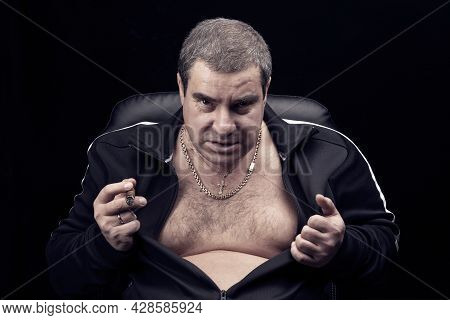 Threatening Look Of The Criminal Of The Russian Mafia, Portrait Of An Adult Dangerous Gangster Man,