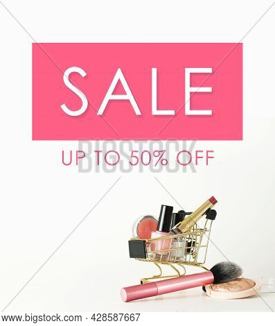 Sale Banner. Shopping Trolley Full Of Make Up And Cosmetic Goods On White Background. Black Friday C