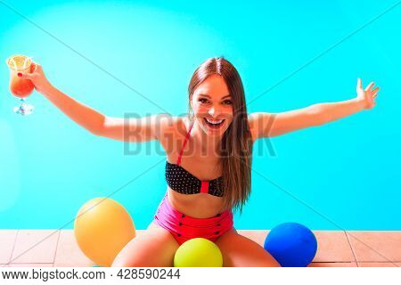 Happy Woman Having Fun With Balloons And Cocktail Drink Alcohol. Pretty Attractive Girl Relaxing At