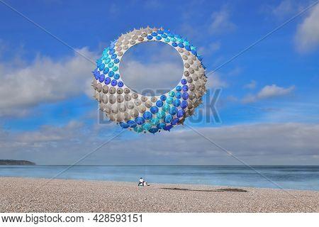 Blue Air Kite In The Sky In Atlantic Ocean