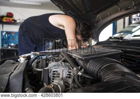 Mechanic At Work On The Car Engine