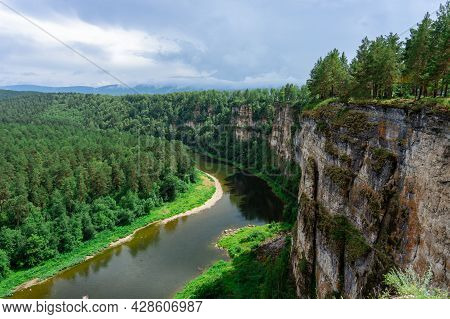 A River In A Mountain Gorge, Aerial View, Filmed From A Drone. River At The Foot Of A Stone Cliff. T
