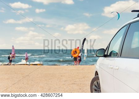Side View Of Big Family White Suv Van Car Parked At Scenic Sand Seaside Campsite Camp Coast Of Sea O