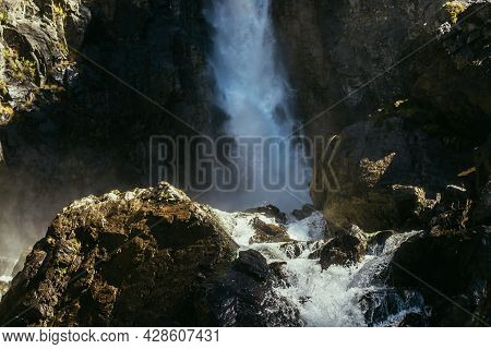 Atmospheric Minimal Landscape With Vertical Big Waterfall On Rock Mountain Wall. Powerful Large Wate