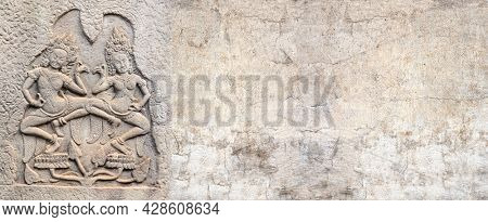 Horizontal background with ancient wall carving with two womans - dancers apsara. Horizontal banner with stone ornament of khmer culture, Angkor, Cambodia. Mock up template. Copy space for text