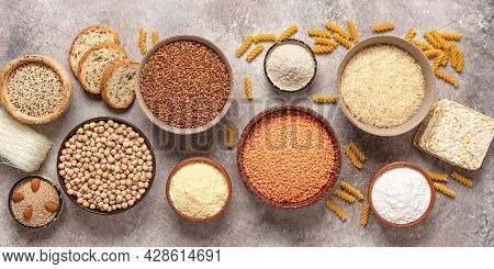 Selection Of Gluten Free Food. A Variety Of Grains, Flours, Pasta, And Bread Gluten-free On A Rustic