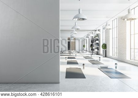 Modern Bright White Yoga Studio Gym Interior With Empty Brick Wall, Window And City View. Mock Up, 3