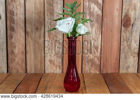 Beautiful Bouquet Of Arranged White Roses Flowers In A Red Vase Given As An Emotional Sentiment Of I