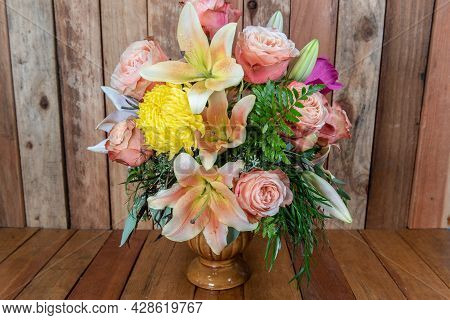 Beautiful Bouquet Of Arranged Roses, Stargazers, And Mum Flowers In A Vase With Some Blooms Yet To O