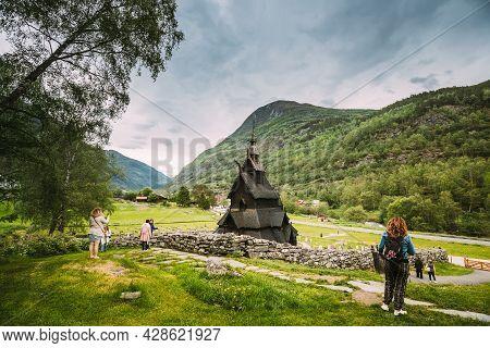 Borgund, Norway - June 14, 2019: People Visiting Famous Landmark Stavkirke An Old Wooden Triple Nave