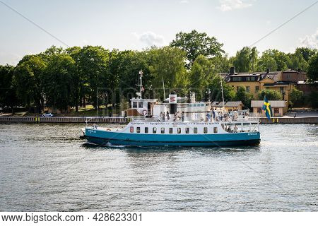 Stockholm, Sweden - July 20, 2021: Side View Of Traditional Steamship Ferry With Passengers Cruising