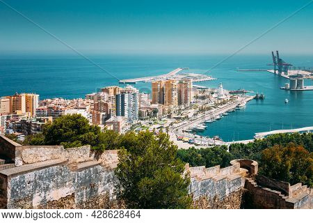 Malaga, Spain. Elevated View, Cityscape View Of Malaga, Spain. Old Fort Walls And Residential Houses