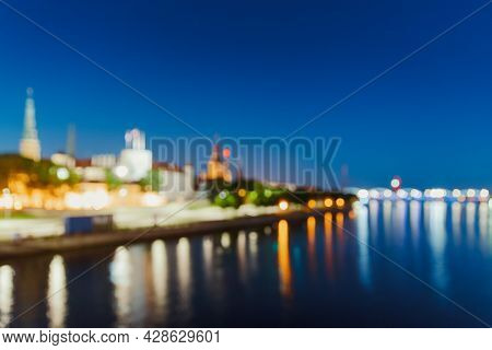 Riga, Latvia. Night Abstract Boke Bokeh Background Effect. Design Backdrop. Dome Cathedral In Evenin